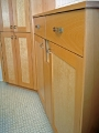 Beech and birdseye maple bathroom cabinets