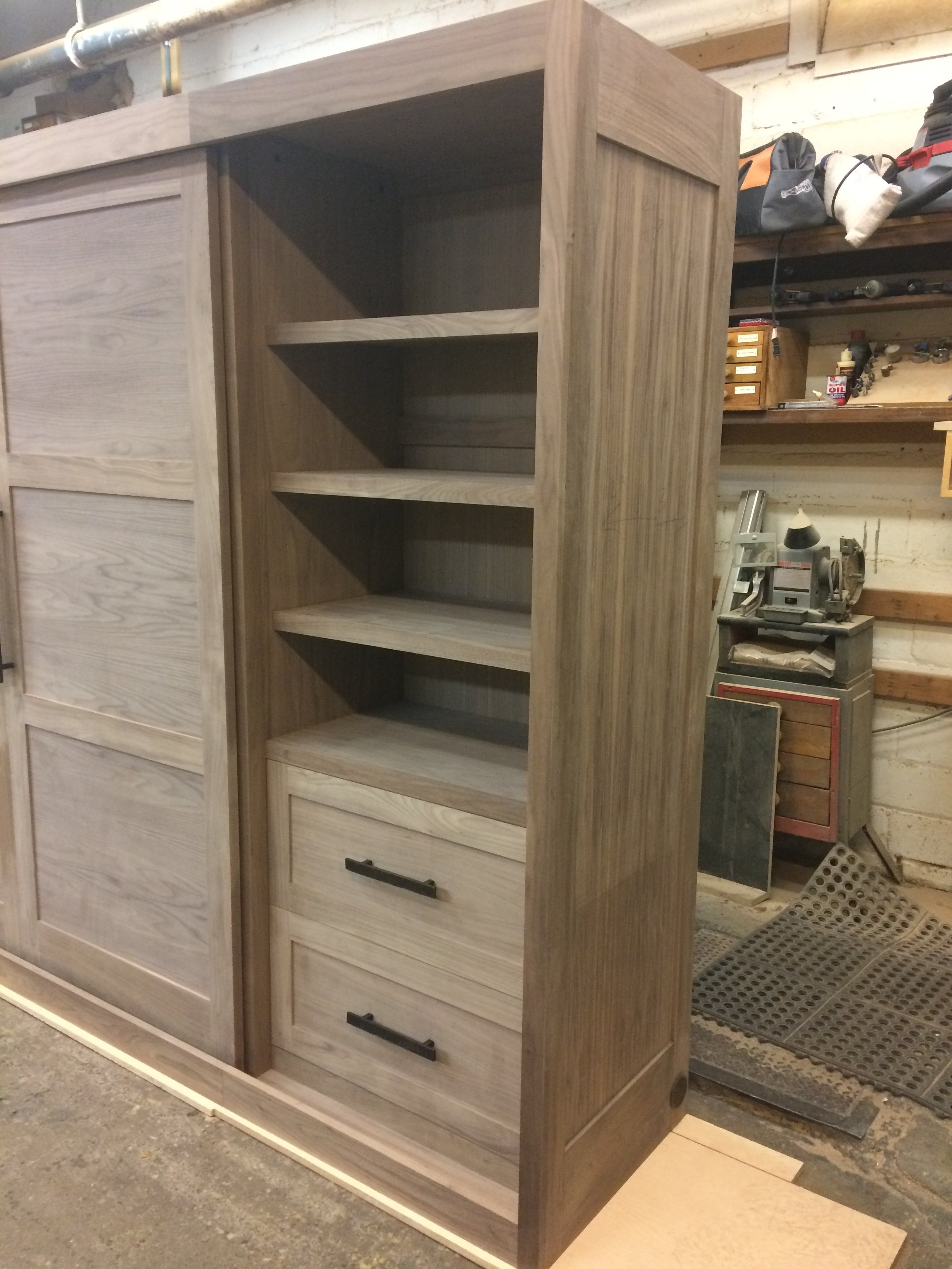 Walnut sliding door media cabinetry