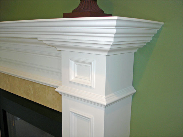 Traditional white fireplace mantel - detail